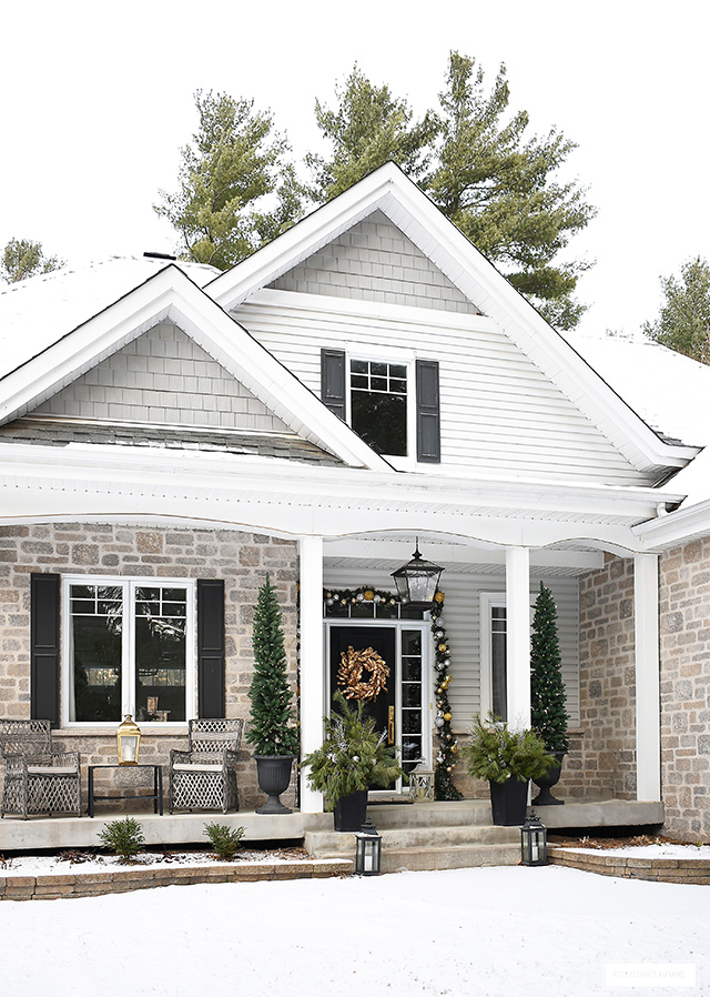 Front porch with elegant Christmas decor.