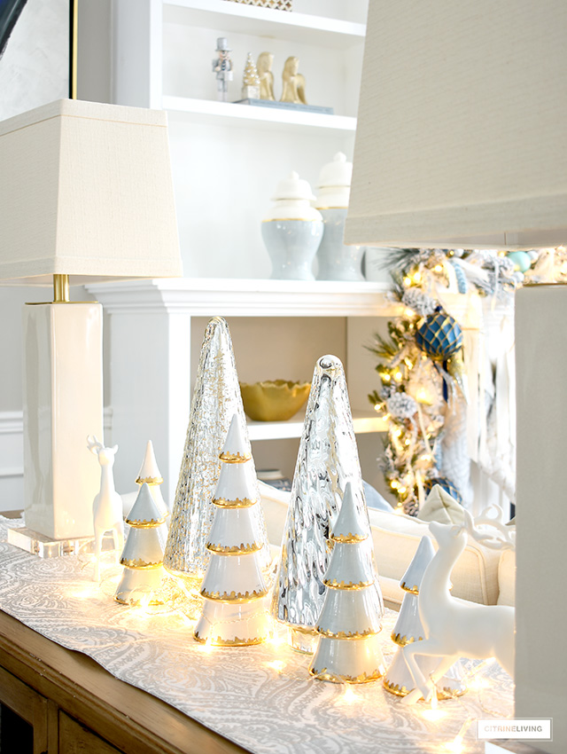 Christmas vignette with gold tipped and mercury glass Christmas trees.