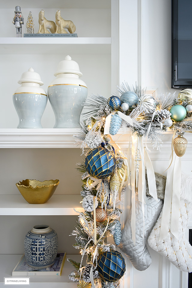 Christmas mantel with flocked garland, blue and gold decorations