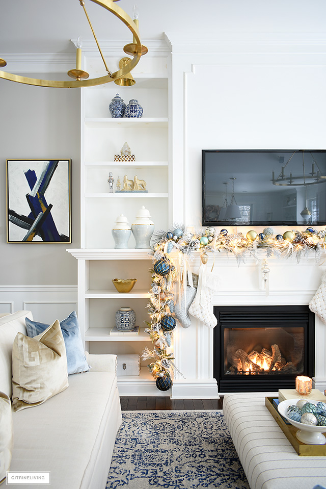 Elegant Christmas living room - mantel with flocked garland