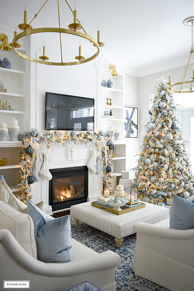 Elegant Christmas living room with flocked tree and garland.