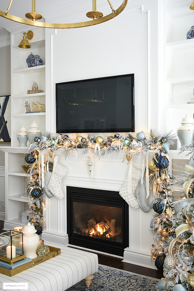 Elegant Christmas living room - Christmas mantel with flocked garland and stockings.