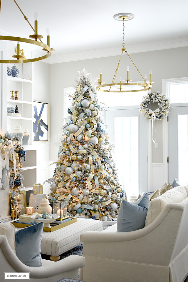 Elegant Christmas living room - flocked Christmas tree with ribbon