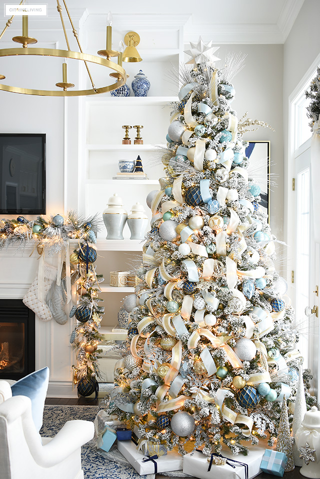 Flocked Christmas tree with light blue, gold, silver and white decorations