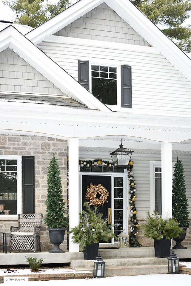 Front porch decorated for Christmas with beautiful and elegant decorations.