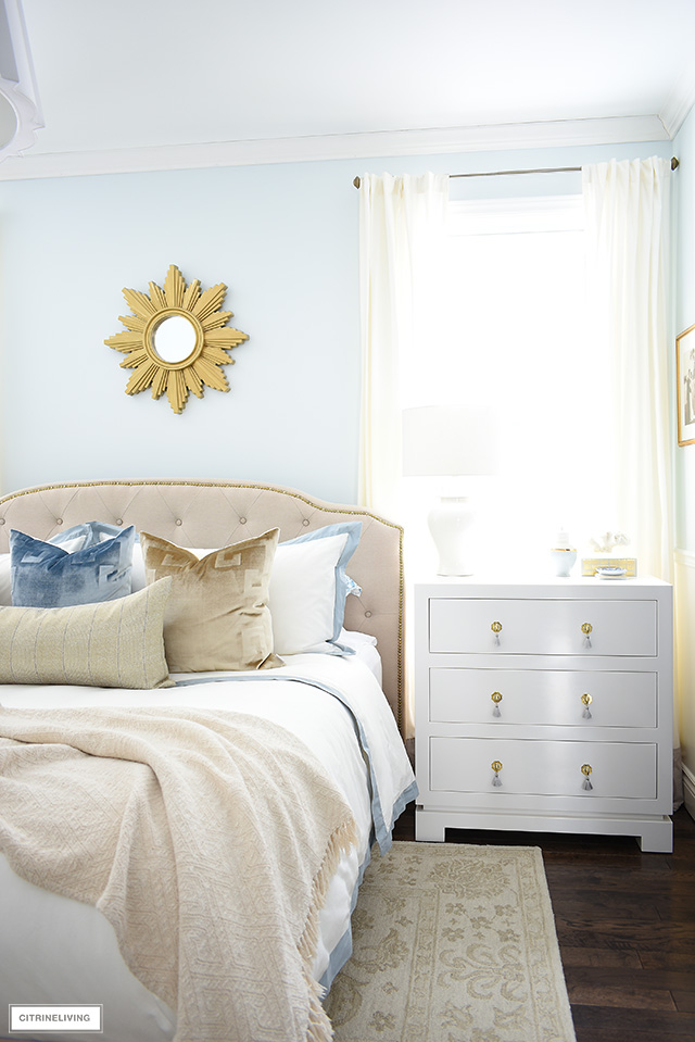 Beautiful three drawer nightstand adds an elegant touch in this beautiful master bedroom.
