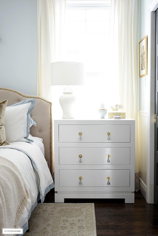 Elegant three drawer dresser used as a practical nightstand.