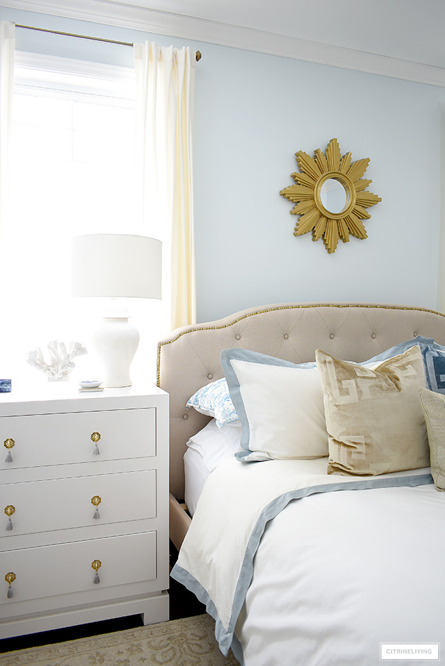 Sophisticated and elegant master bedroom color palette with soft blue, gold, beige and layers of creamy white.