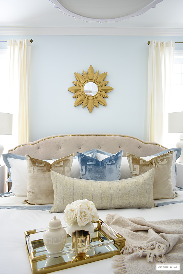 Style your bed with layers of luxe bedding, velvet pillows, throw blanket and a chic tray with pretty accessories.