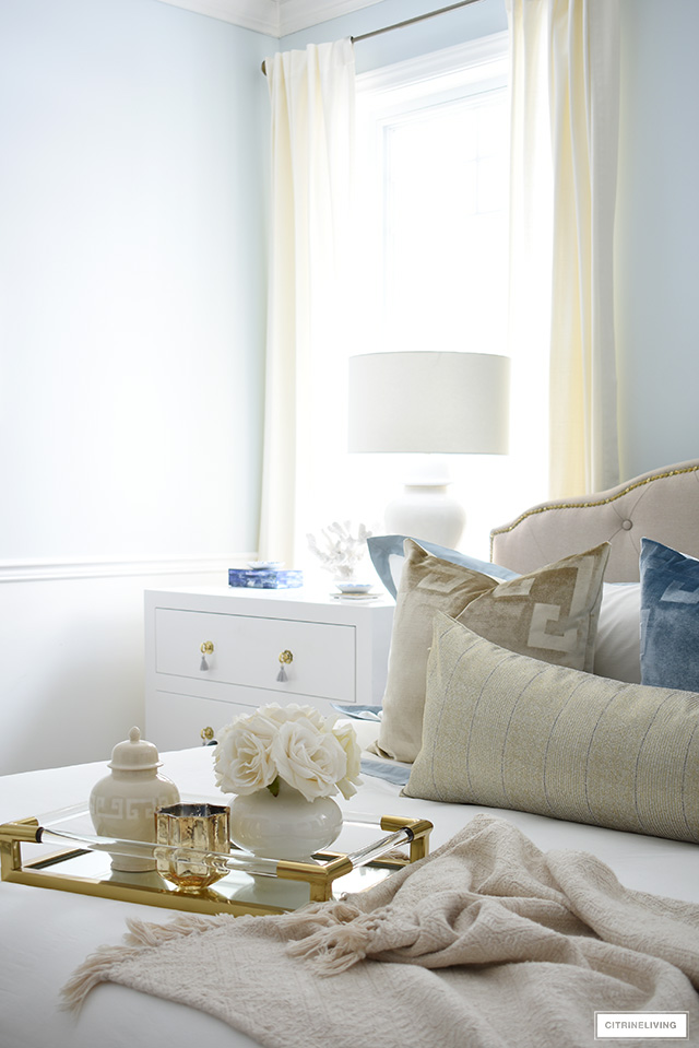 Beautiful layered bed with a chic tray and pretty accessories.