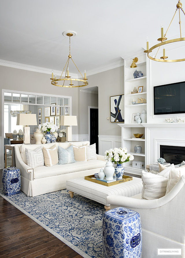 Beautiful living room decorating for spring - light blue accents and soft neutral tones.