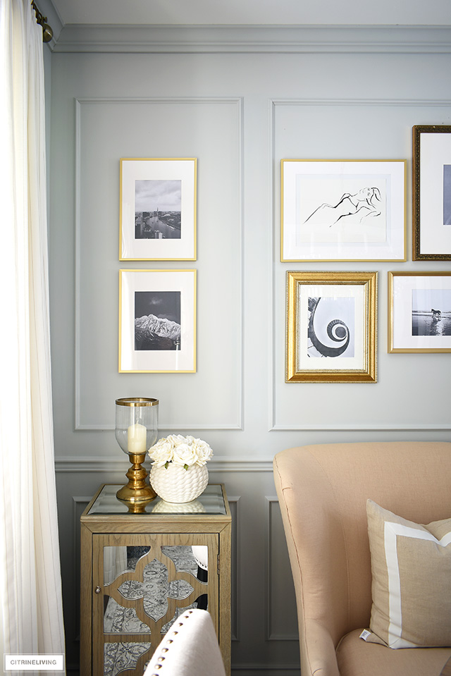 A sophisticated mix of black and white photography and illustration creates a stunning gallery wall.