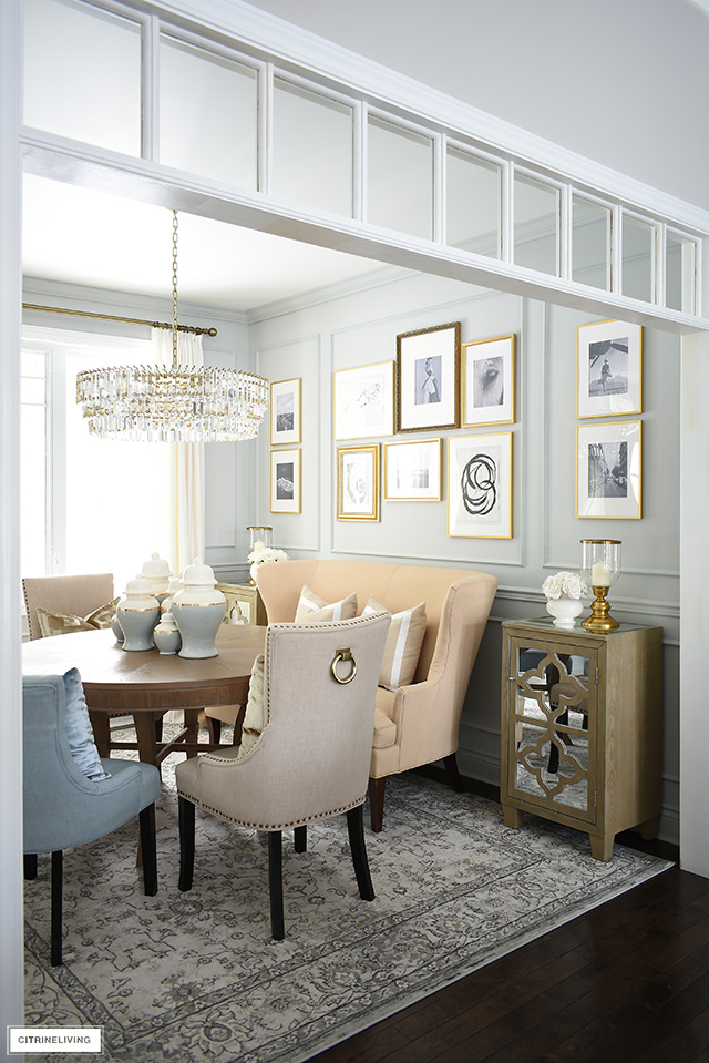 Elegant dining room with layers of curated furniture, a sophisticated and inexpensive gallery wall creates a sense of old-world sophistication.