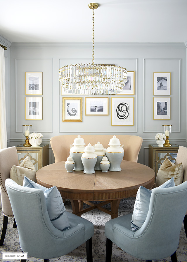 A curated dining room with beautifully layered furnishings and an inexpensive DIY gallery wall is elegant and chic!