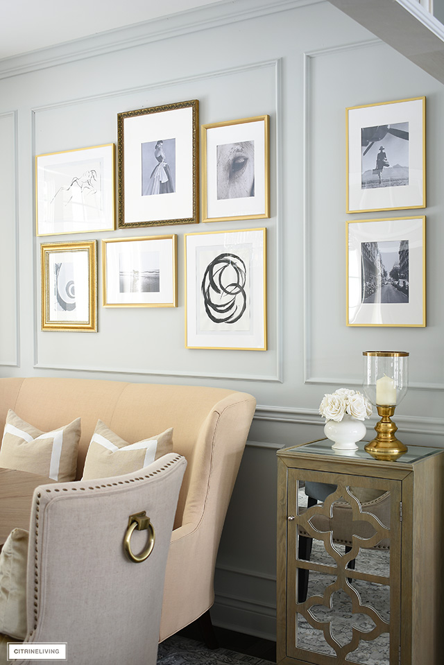 Inexpensive DIY gallery wall with a mix of black and white photography and homemade art.