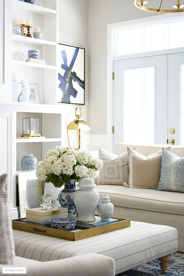 Spring decorating ideas - faux florals, blue and white, ginger jars and beautiful printed throw pillows.