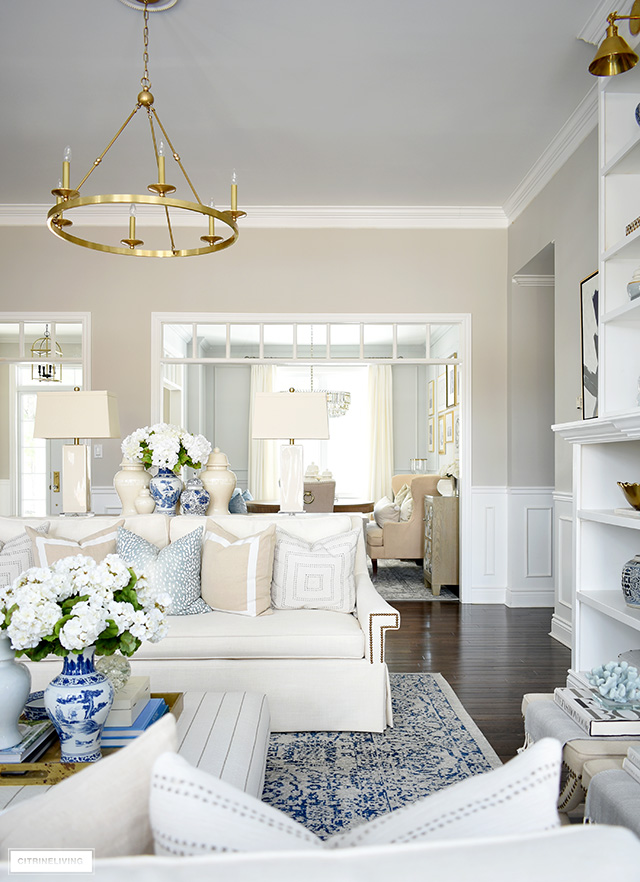 Living room decorating ideas for spring - a soft blue, beige and warm white color palette is fresh and airy.
