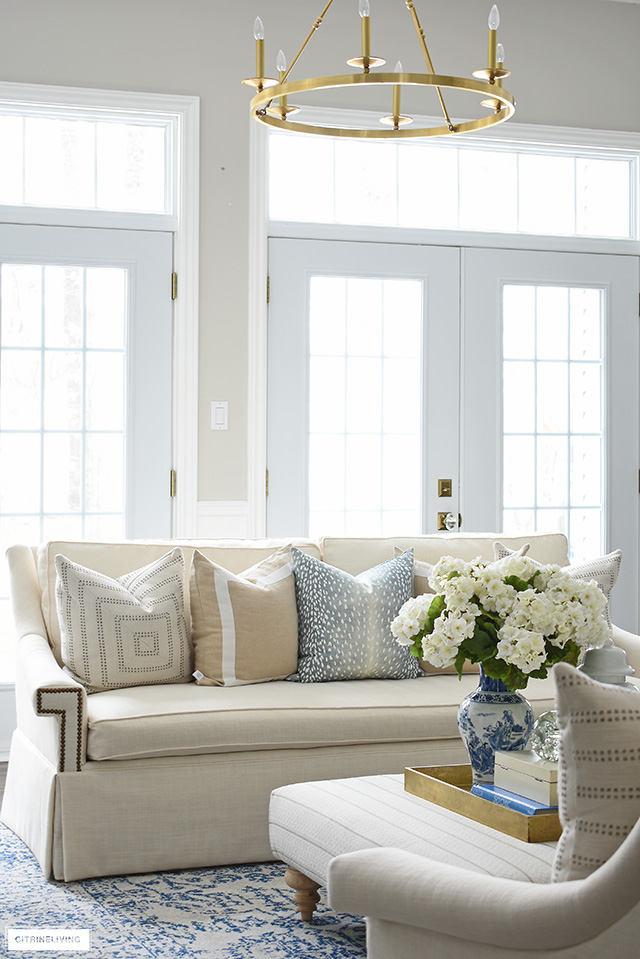 Gorgeous sophisticated yet casual living room with elegant spring decorating.
