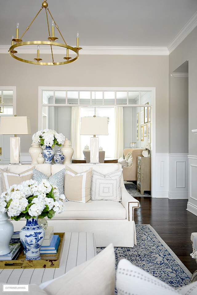 Spring decorating ideas with faux flowers, blue and white vases and ginger jars.
