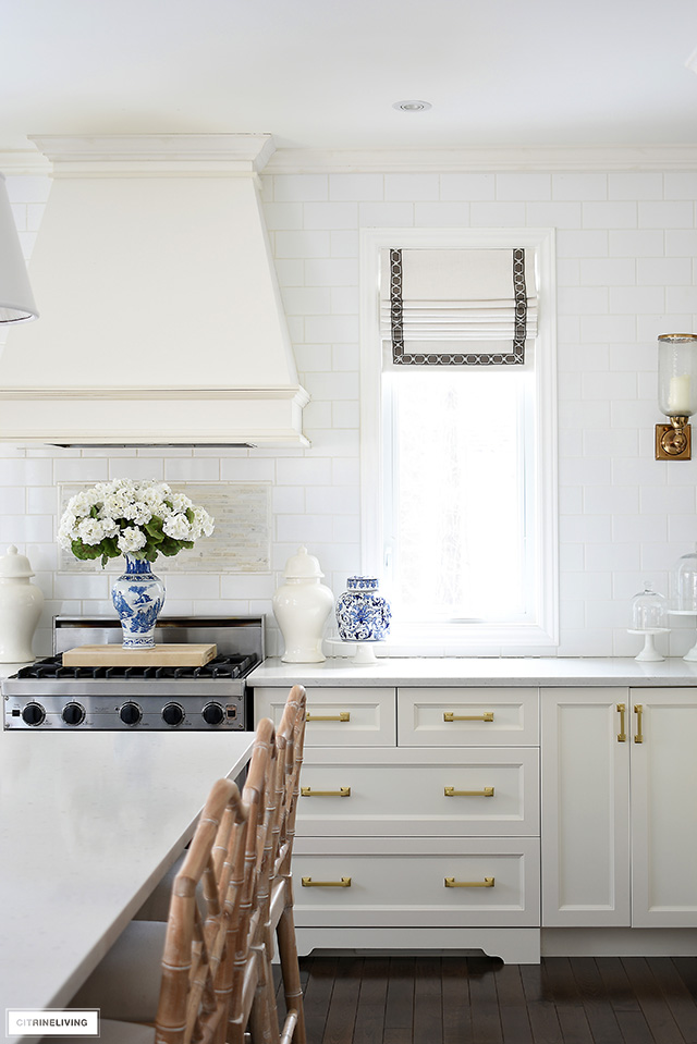 A chic and sophisticated kitchen with blue and white accessories for spring.