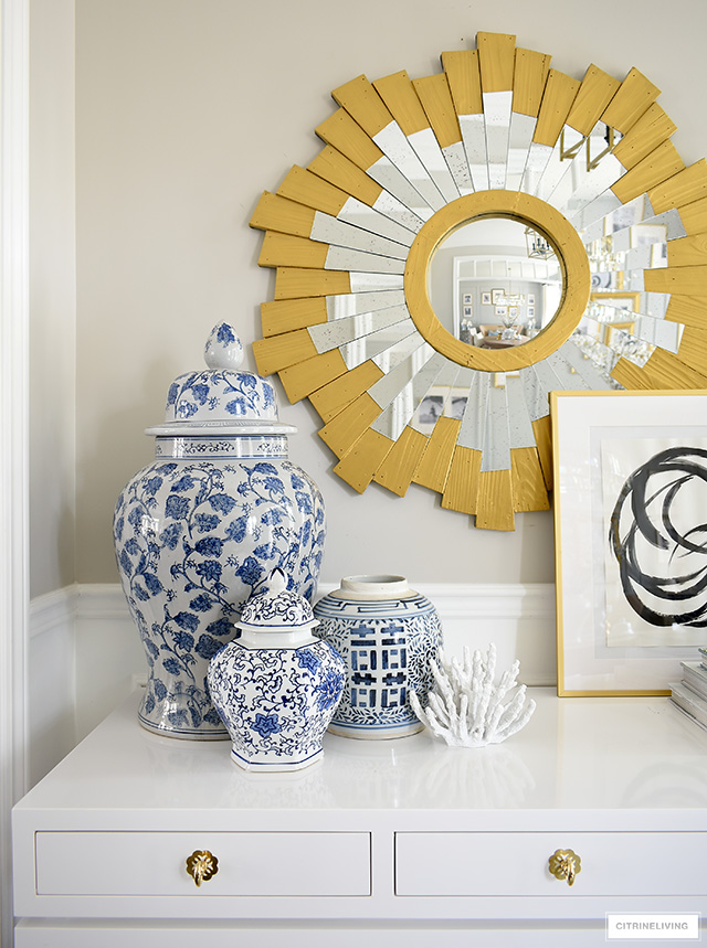 Console table styling ideas with blue and white ginger jars, coral sculptures and modern art.