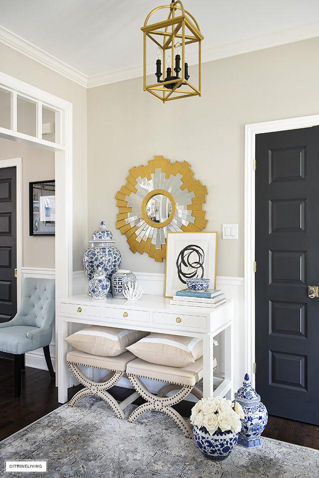 Syle your console table with chinoiserie chic blue and white pieces paired with gold accents.