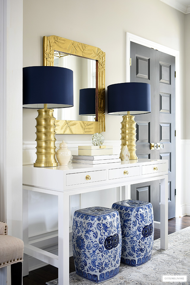 Style a console table with classic garden stools, brass lamps and chic accessories for a contemporary and chic look.