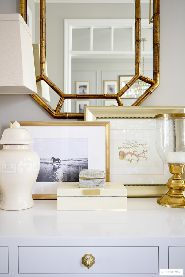 Style a console table with a coastal-chic vibe using beach-themed framed artwork.