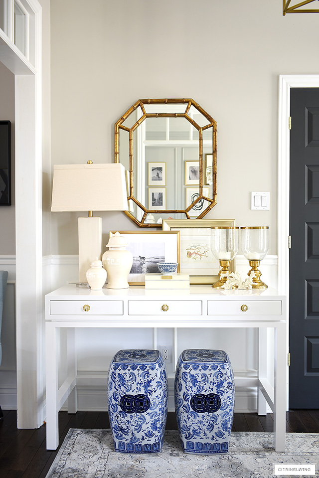 Gorgeous console table styling ideas with a coastal-chic look! Touches of blue and white layered in with neutral accessories is fresh and vibrant!