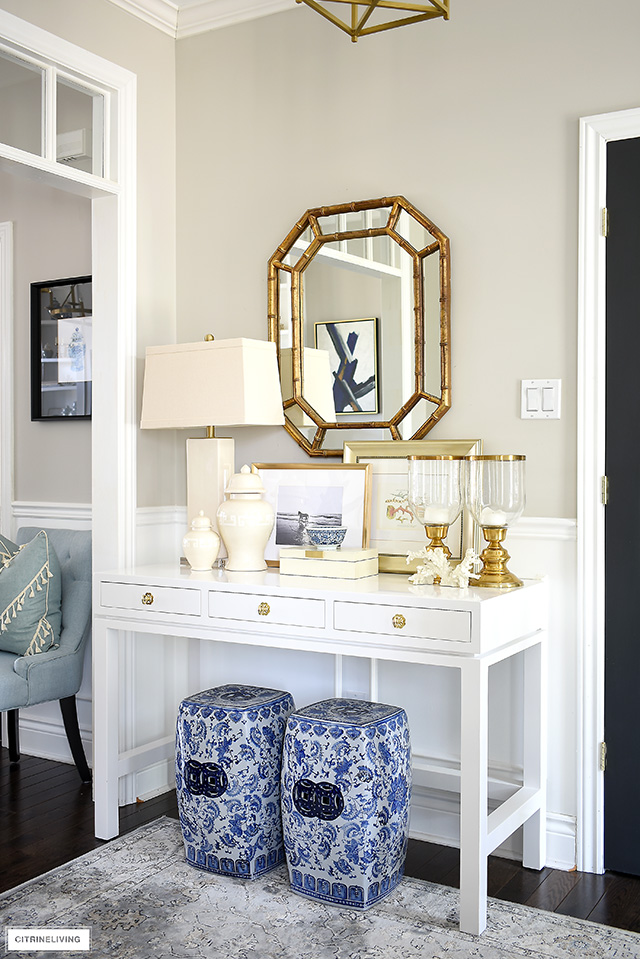 Style your console with a pop of color among and all-neutral vignette for a fun but sophisticated look.