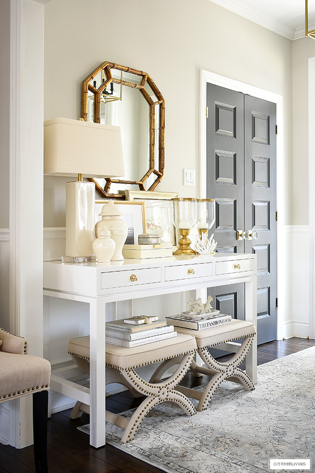 A gorgeous console table with a coastal-chic look! Layer neutral accessories and art for a classic look.
