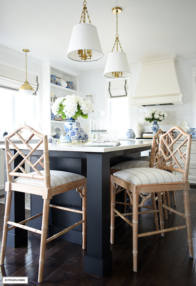 Recovered bar stools give this kitchen a fun update! Learn how to recover stools or chairs easily!