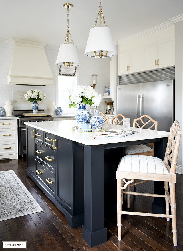 Recovered barstools bring a whole new look to this kitchen! Find out how to recover bar stools or chairs in a few hours!