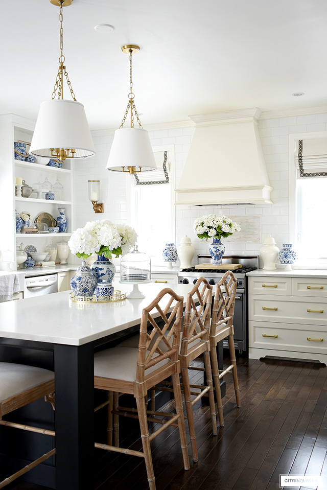 Gorgeous kitchen spring decorating ideas featuring blue and white styled accessories throughout.