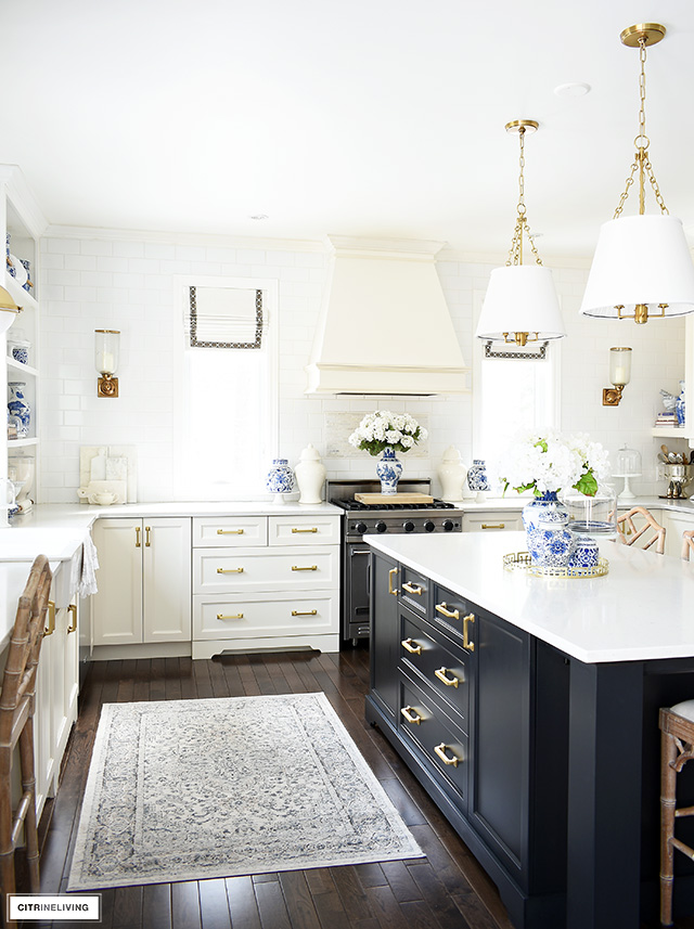 Beautiful and classic kitchen with vibrant spring decor featuring blue and white chinoiserie pieces.