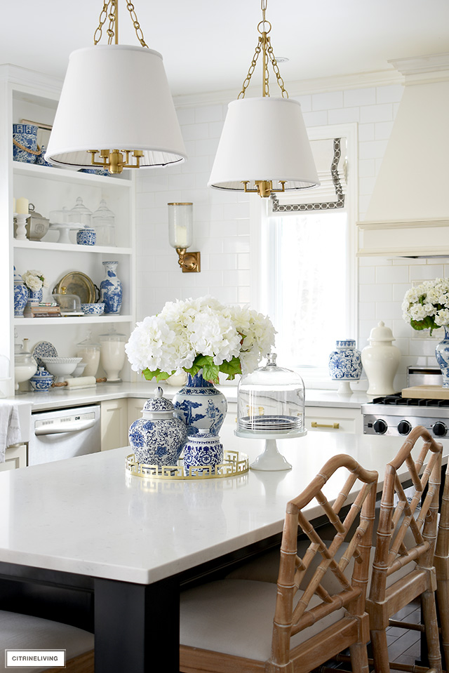 Beautiful fresh spring kitchen decorating with blue and white accessories.
