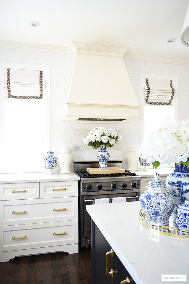 Fresh blue and white accessories and faux florals make a gorgeous statement in this spring kitchen.