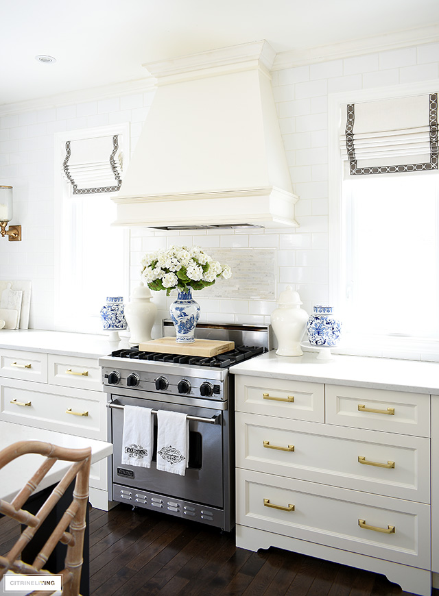 Spring kitchen decorating with gorgeous ginger jars, faux florals and blue and white pieces.