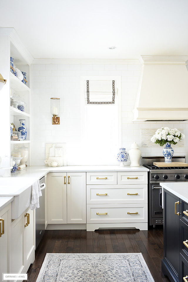 Elegant kitchen featuring blue and white accessories for spring.