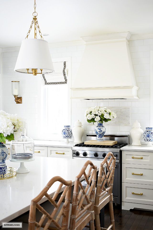 Beautiful blue and white accessories elevate this kitchen for spring with a fresh and vibrant look.