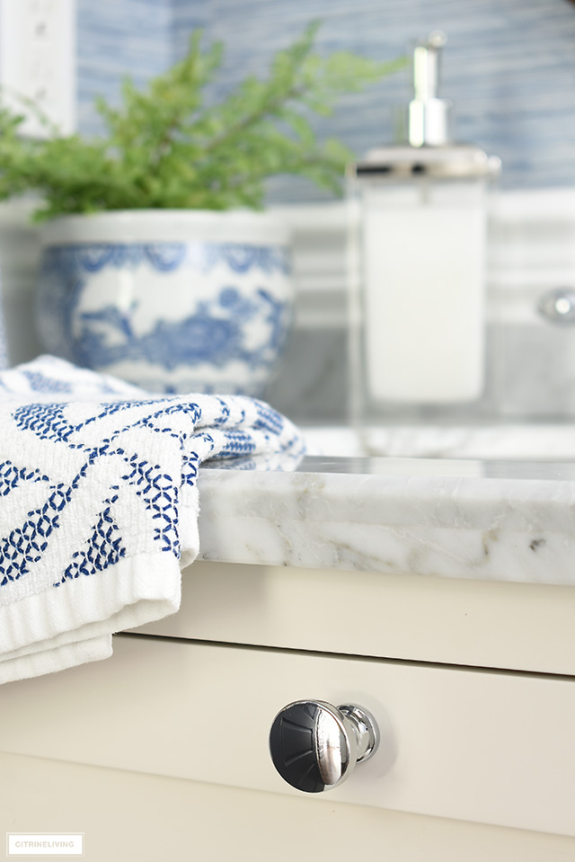 Classic silver bathroom vanity drawer knob.