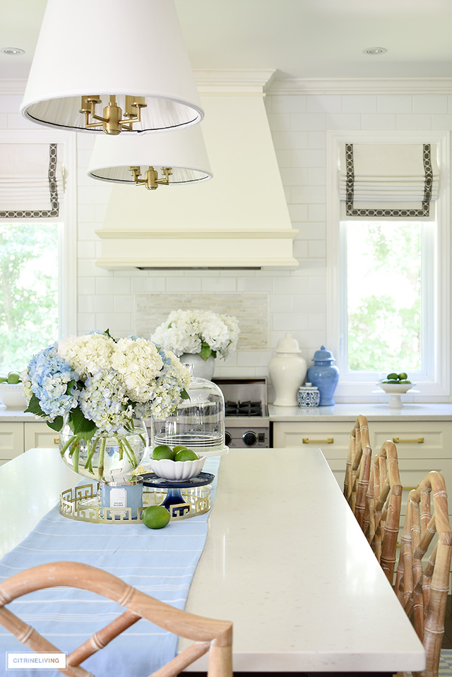 White kitchen with blue and white hydrangeas and ginger jars for summer.