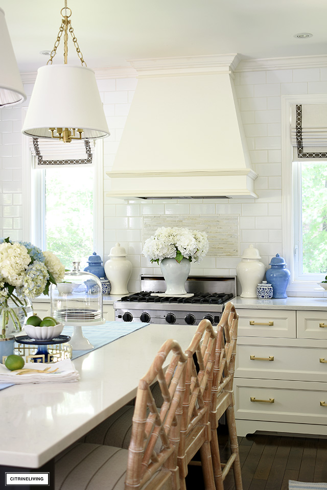 Kitchen with fresh and faux hydrangeas, blue and white ginger jars for summer.