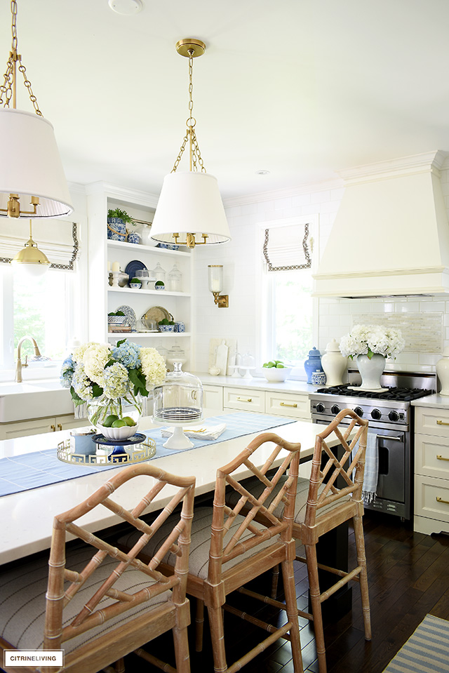 Kitchen with Chippendale bar stools, blue and white accessories for summer.