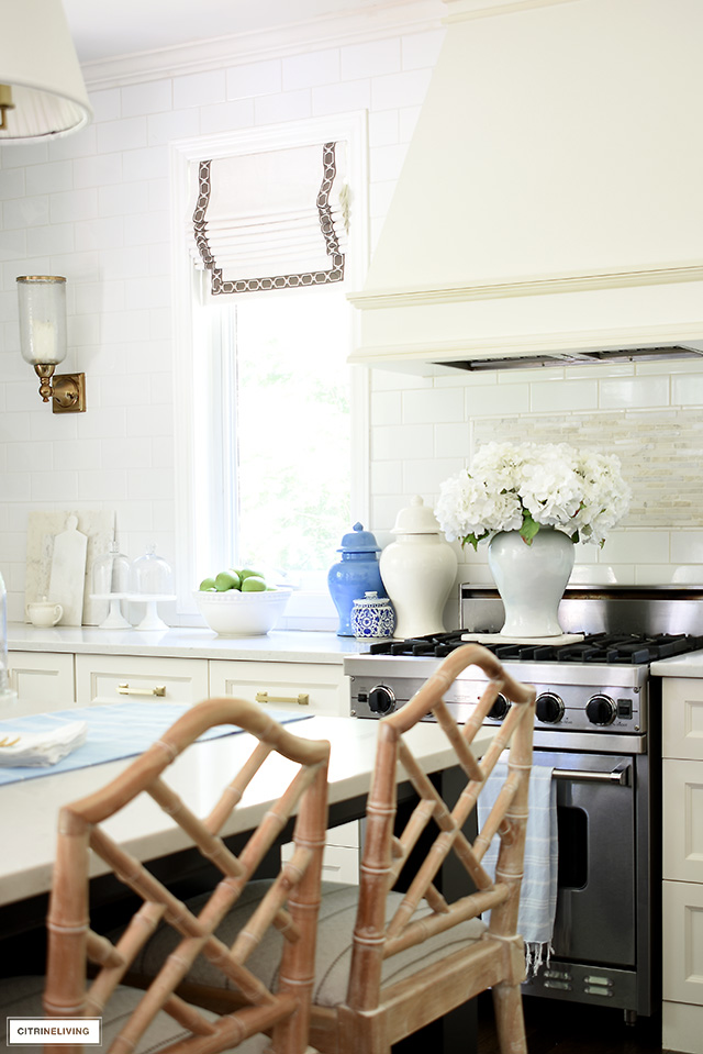 Kitchen decorating details wit ginger jars and faux hydrangeas.