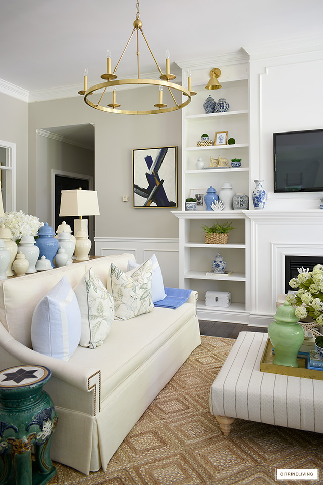 Gorgeous summer decorated living room with pretty blue, green and natural accents.