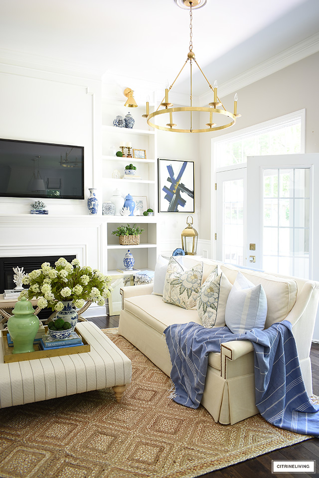 Living room decorated for summer with beautiful blues, vibrant greens and natural elements and textures.