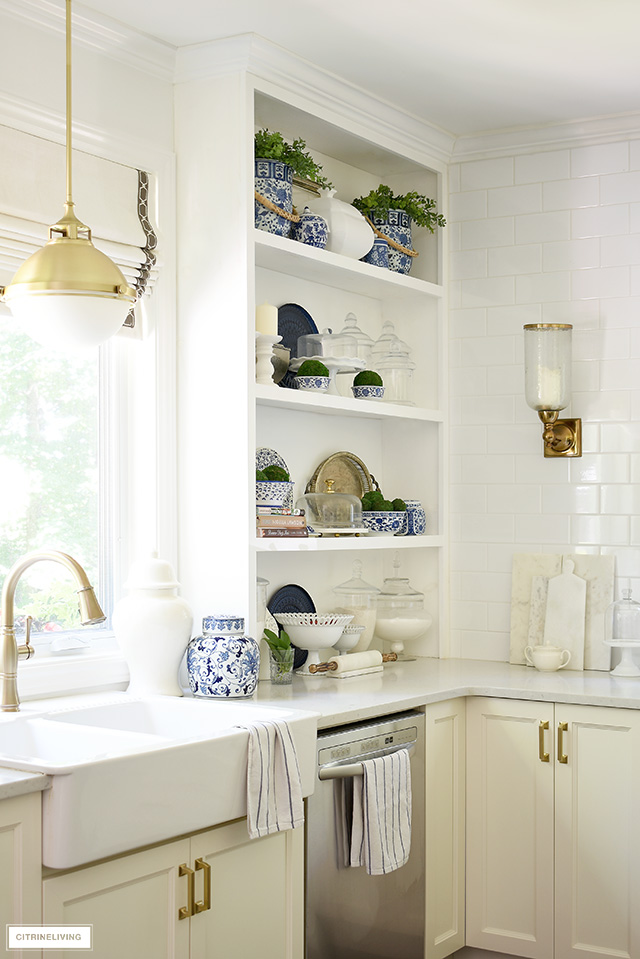 Built-in kitchen shelves with blue and white chinoiserie and touches of greenery.