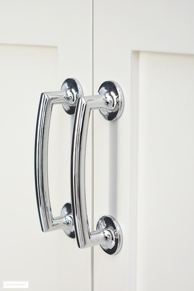 Beautiful arch shaped silver bathroom hardware.