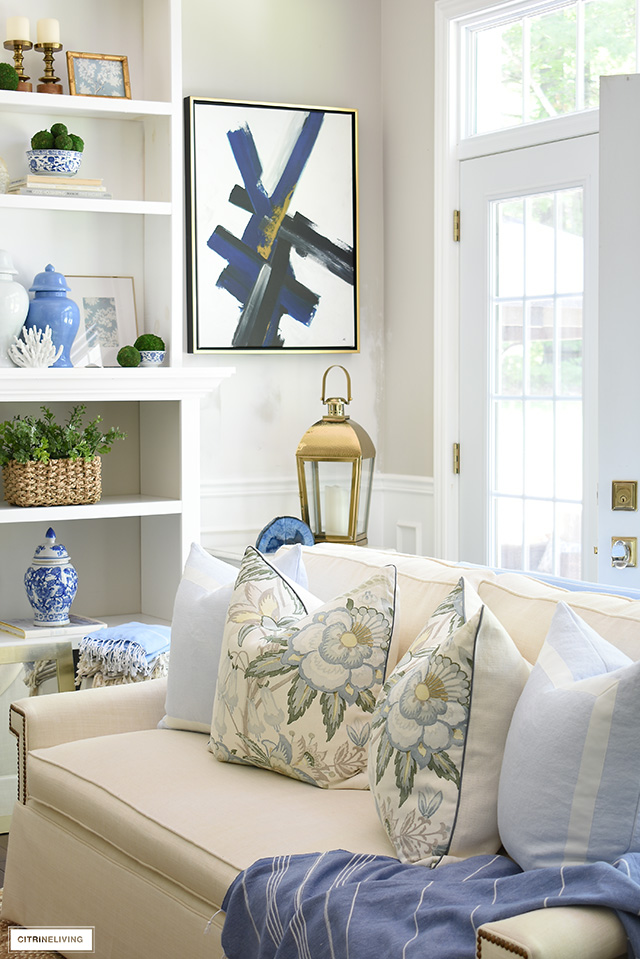 Summer decorated living room with beautiful blue, green, floral prints and natural elements creates breezy, casual look!